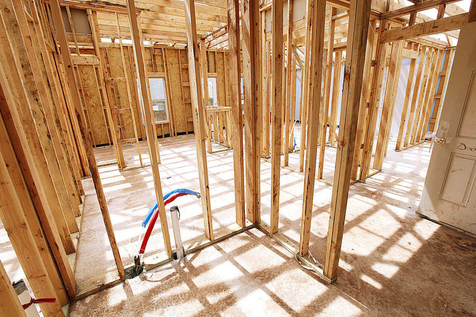 Photo - Rooms are in the framing stage of a home under construction at 2612 NW 184.  PAUL B. SOUTHERLAND - The Oklahoman