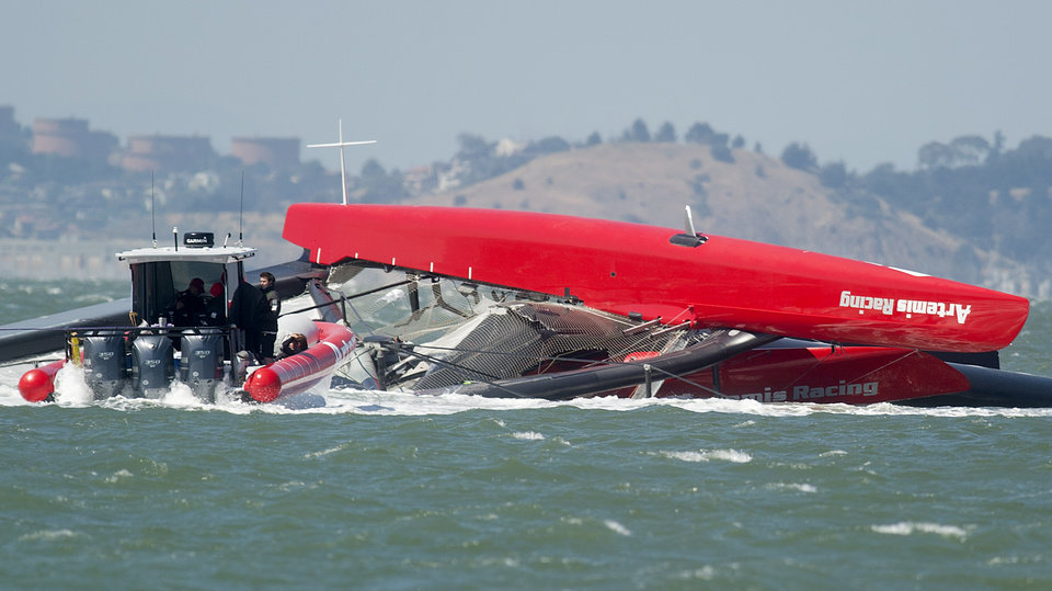 Photo - The Artemis Racing AC72 catamaran, an America's Cup entry from Sweden, lies capsized after turning over during training in San Francisco Bay on Thursday, May 9, 2013, in San Francisco. Artemis Racing said Andrew