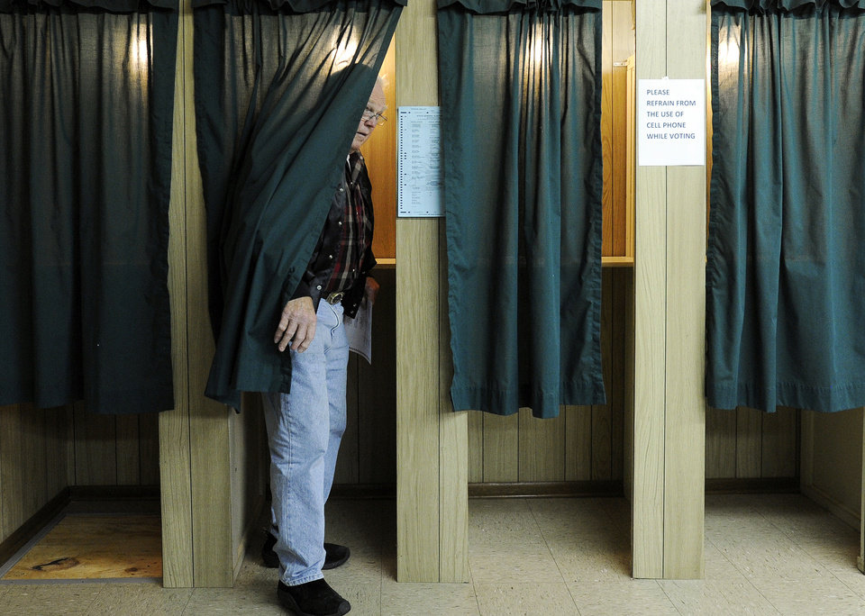 Photo -   Greg Kerrigan of Minnesota City comes out of the polling booth while voting at the Rollingstone Township Hall near Rollingstone, Minn., on Tuesday, Nov. 6, 2012. After a grinding presidential campaign, Americans are heading into polling places across the country.(AP Photo/Winona Daily News, Andrew Link)
