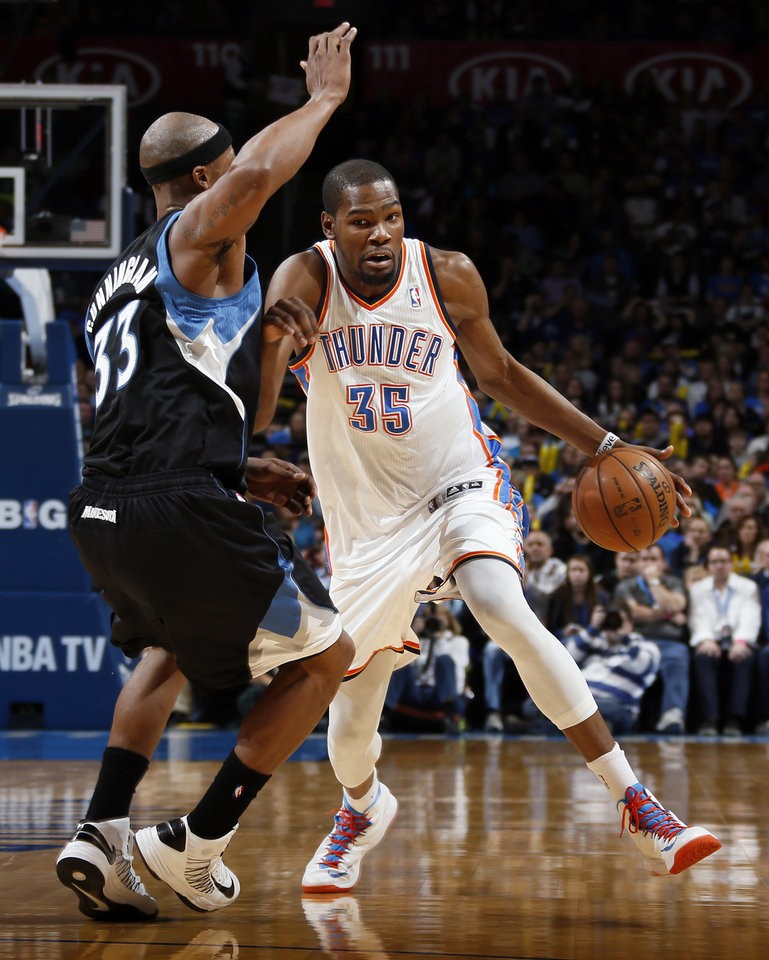 Oklahoma City\'s Kevin Durant (35) drives against Minnesota\'s Dante Cunningham (33) during an NBA basketball game between the Oklahoma City Thunder and Minnesota Timberwolves at Chesapeake Energy Arena in Oklahoma City, Friday, Feb. 22, 2013. Photo by Nate Billings, The Oklahoman
