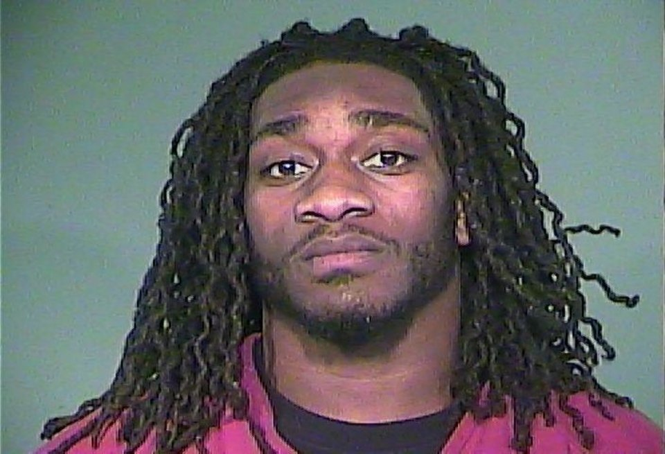 A photo released by the Knox County Sheriff's office is the booking photo of Tennessee linebacker A.J. Johnson. Johnson and two others  were taken into custody by police in Tennessee late Saturday for alcohol related charges and for resisting arrest.  (AP Photo/The Knoxville News Sentinel, )