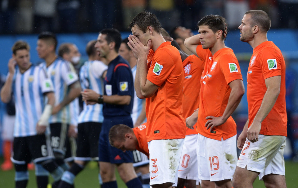 Photo - Netherlands' Stefan de Vrij, centre, reacts during a shootout at the end of the World Cup semifinal soccer match between the Netherlands and Argentina at the Itaquerao Stadium in Sao Paulo Brazil, Wednesday, July 9, 2014. Argentina won 4-2 on penalties after the match ended 0-0 after extra time.  (AP Photo/Manu Fernandez)