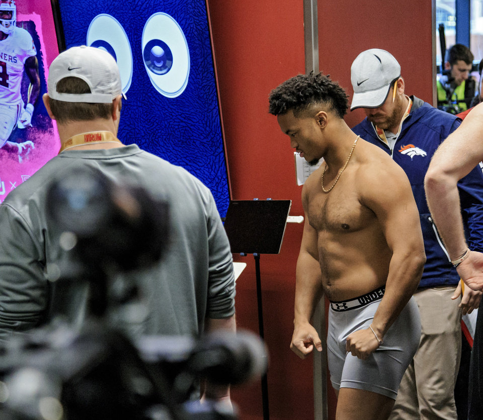 Photo - Kyler Murray prepares to weigh in for NFL scouts during the University of Oklahoma football pro day at the University of Oklahoma in Norman, Okla. on Wednesday, March 13, 2019.   Photo by Chris Landsberger, The Oklahoman