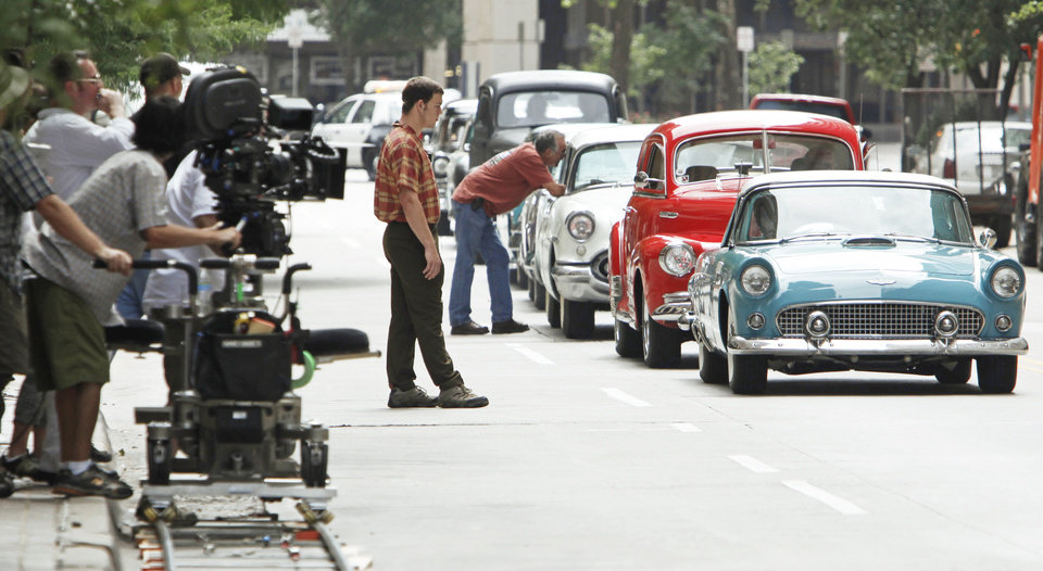 "Photo - Cars line up for a shot on the set of ""The Killer Inside Me"" on Saturday in downtown Oklahoma City.  Photo by NATE BILLINGS, THE OKLAHOMAN"