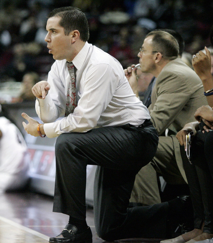 Photo - Ole Miss's coach Matt Insell is called for a techincal foul during the first half of an NCAA college basketball game against Ole Miss,Thursday, Jan. 30, 2014, in Columbia, S.C. South Carolina won 99-70. (AP Photo/Mary Ann Chastain)