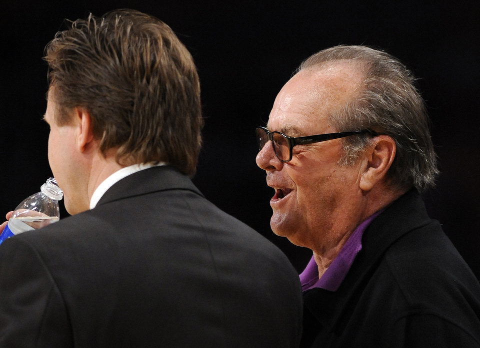 Photo - L.A. LAKERS / NBA PLAYOFFS: Actor Jack Nicholson, right, talks in the ear of Oklahoma City Thunder coach Scott Brooks during the second half in Game 5 of a first-round NBA basketball playoff series, Tuesday, April 27, 2010, in Los Angeles. The Lakers won 111-87. (AP Photo/Mark J. Terrill) ORG XMIT: LAS207