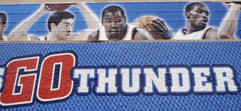 Photo - A sign supports the Thunder game five of the Western Conference semifinals between the Memphis Grizzlies and the Oklahoma City Thunder in the NBA basketball playoffs at Oklahoma City Arena in Oklahoma City, Wednesday, May 11, 2011. Photo by Sarah Phipps, The Oklahoman