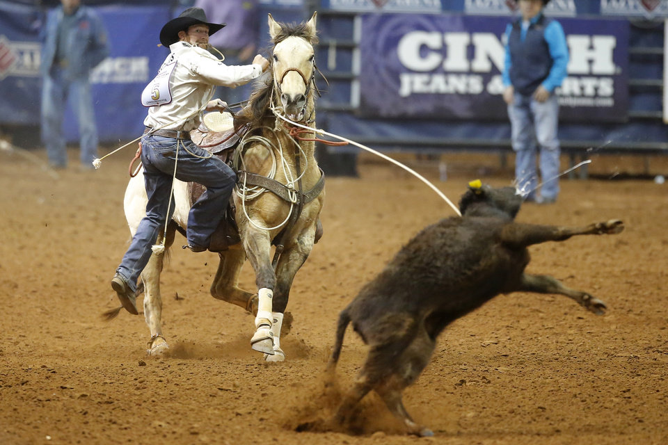 Photo - Paul D. Tierney of Oklahoma City competes in the tie-down roping event during the Timed Event Championship inside the Lazy E Arena in Guthrie, Okla., Thursday, March 13, 2020. [Bryan Terry/The Oklahoman]