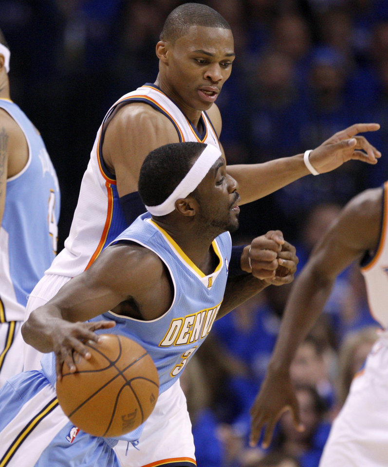 Photo - Oklahoma City's Russell Westbrook (0) defends Denver's Ty Lawson (3) during the NBA basketball game between the Denver Nuggets and the Oklahoma City Thunder in the first round of the NBA playoffs at the Oklahoma City Arena, Sunday, April 17, 2011. Photo by Bryan Terry, The Oklahoman