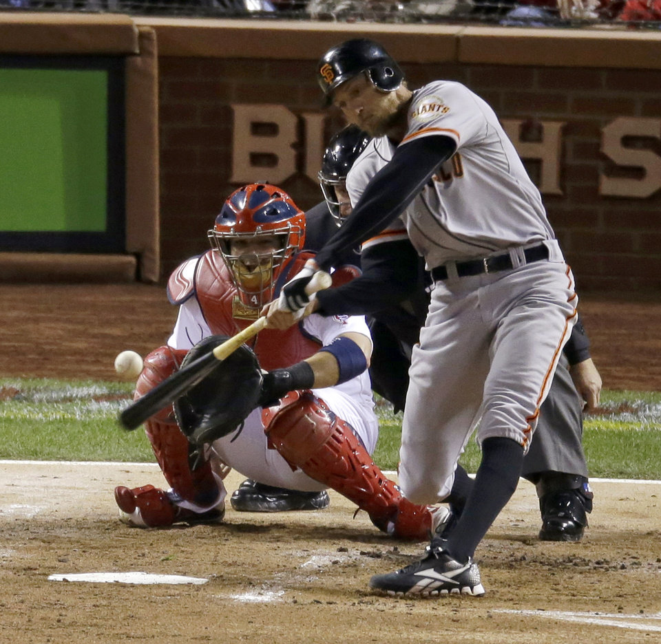 Photo -   San Francisco Giants' Hunter Pence hits a home run during the second inning of Game 4 of baseball's National League championship series against the St. Louis Cardinals Thursday, Oct. 18, 2012, in St. Louis. (AP Photo/Mark Humphrey)