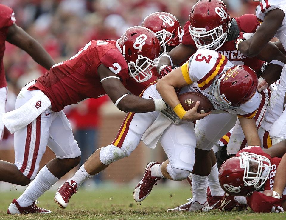 The Oklahoma defense stops Iowa State\'s Grant Rohach (3) during the college football game between the University of Oklahoma Sooners (OU) and the Iowa State University Cyclones (ISU) at Gaylord Family-Oklahoma Memorial Stadium in Norman, Okla. on Saturday, Nov. 16, 2013. Photo by Chris Landsberger, The Oklahoman
