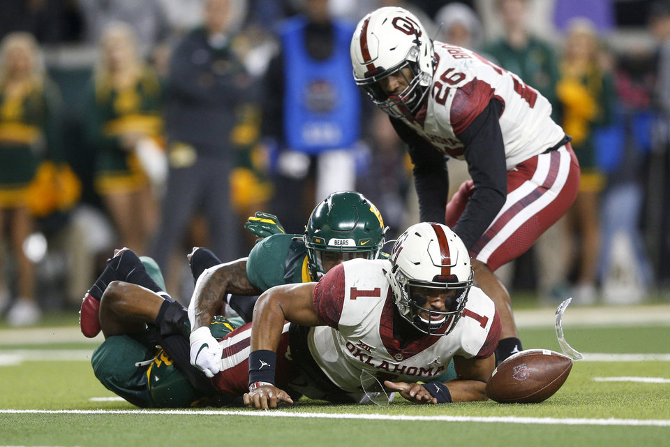 Photo - Oklahoma quarterback Jalen Hurts (1) attempts to recover a fumble while being tackled by Baylor safety Henry Black (8) and safety Chris Miller (3) during an NCAA college football game, in Waco, Texas, Saturday, Nov. 16, 2019. (Ian Maule/Tulsa World via AP)