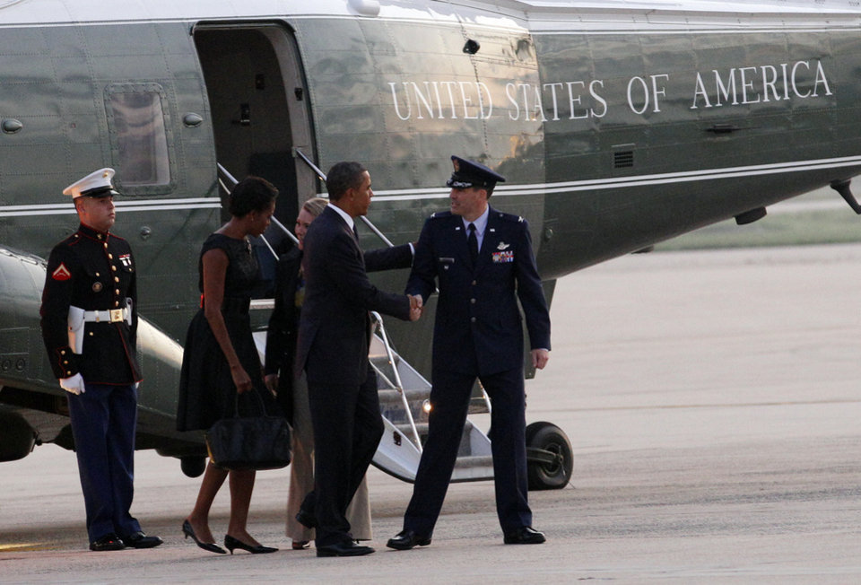 President Barack Obama and first lady Michelle Obama are welcomed by Col. Greg Urtzo, 11th Wing Vice Commander and his wife Kelly upon arrival at Andrews Air Force Base, Sunday, Sept, 11, 2011. Ten years after 9/11 terror attacks, Barack Obama and first lady Michelle Obama are traveling to New York and and Shanksville, Penn., to attend memorial services and then to the Pentagon later in the day.(AP Photo/Jose Luis Magana)
