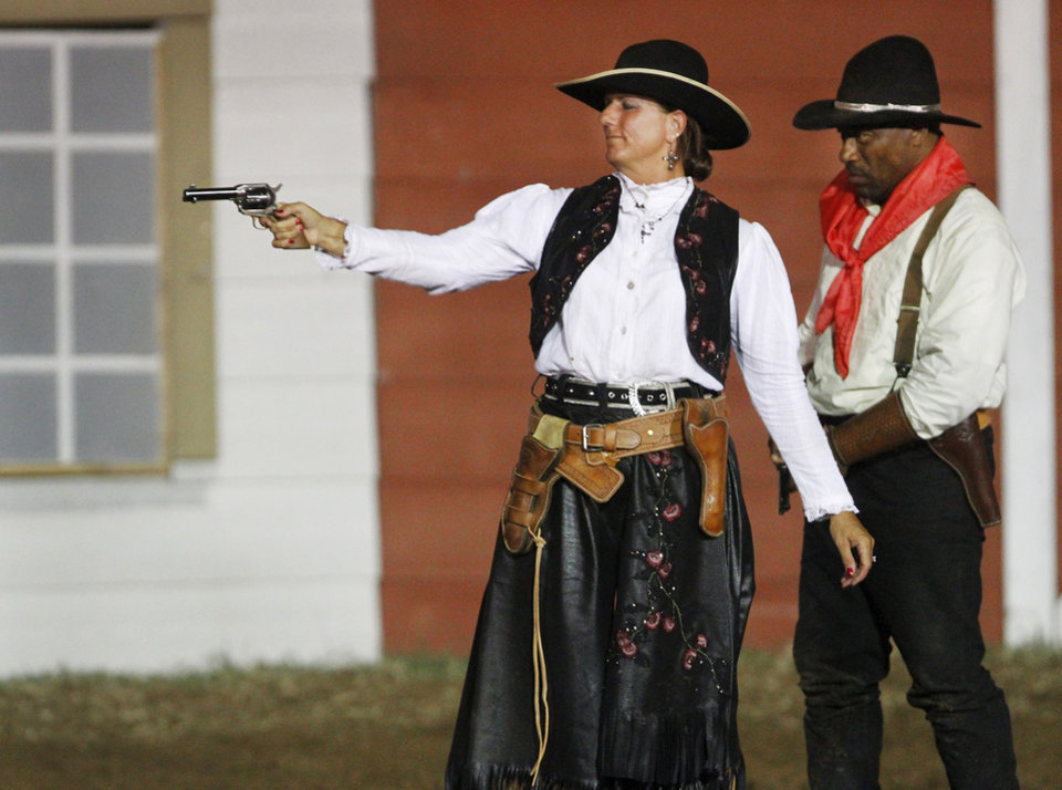 Photo - Wanda Green portrays trick shooter May Lillie, wife of Pawnee Bill, during  the Pawnee Bill Wild West Show in Pawnee, Oklahoma on Saturday,  June 23, 2012.  Photo by Jim Beckel, The Oklahoman