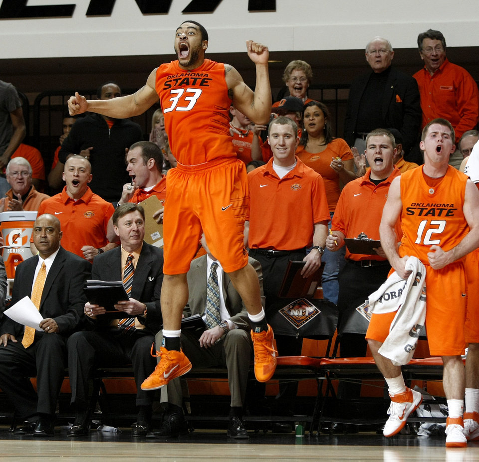 Photo - Oklahoma State's Marshall Moses (33) and Oklahoma State's Keiton Page (12) celebrate during a first-round NIT college basketball game between Oklahoma State University (OSU) and Harvard at Gallagher-Iba Arena in Stillwater, Okla., Tuesday, March 15, 2011. Photo by Bryan Terry, The Oklahoman