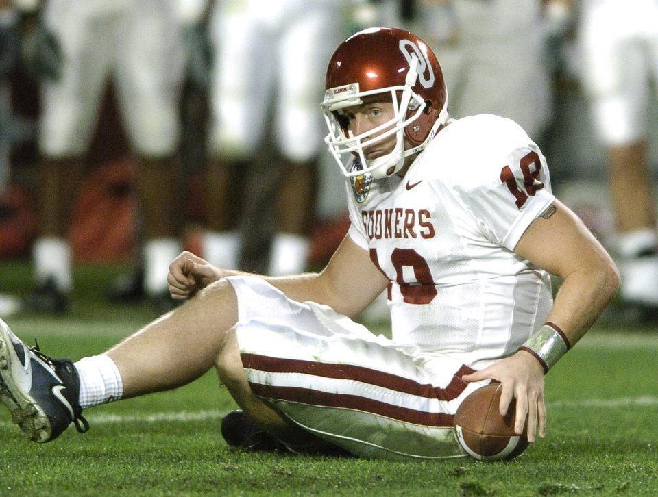 Miami, Florida - January 4, 2005. University of Oklahoma (OU) Sooners vs. University of Southern California (USC) Trojans college football in the Orange Bowl BCS National Championship at Pro Player Stadium. Oklahoma's Jason White picks himself up after a tackle in the third quarter against USC.  By Steve Sisney/The Oklahoman