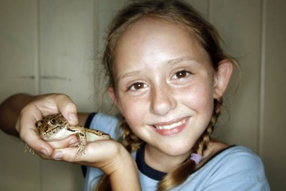 Photo -  Lauren Cochell, 7, poses with a frog after the frog and turtle races, Wednesday, June 24, 2009, at  Camp DaKaNi in Oklahoma City. Photo by Sarah Phipps, The Oklahoman