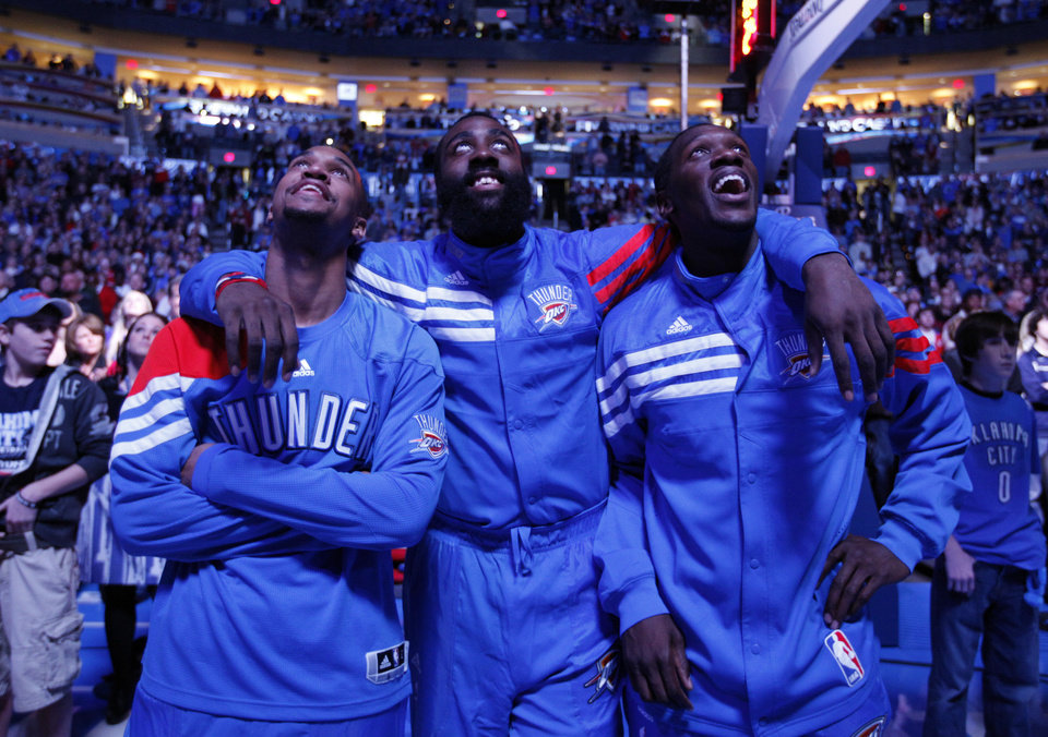 Oklahoma City Thunder's Eric Maynor (6), James Harden (13) and Reggie Jackson (15) watch a video before the opening day NBA basketball game between the Oklahoma CIty Thunder and the Orlando Magic at Chesapeake Energy Arena in Oklahoma City, Sunday, Dec. 25, 2011. Photo by Sarah Phipps, The Oklahoman