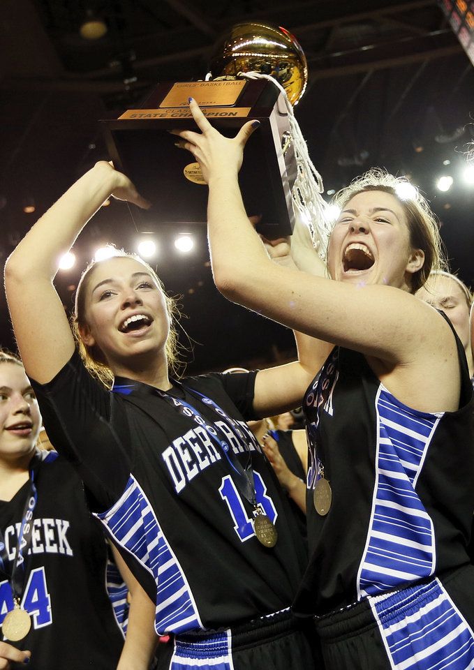Photo - Deer Creek's Whitney Jones (13), left, and Bayli Blanchard (32) celebrate with the gold ball trophy after the Class 5A girls championship game in the state high school basketball tournament between Deer Creek and Tulsa East Central at the Mabee Center in Tulsa, Okla., Saturday, March 15, 2014. Deer Creek won, 31-28. Photo by Nate Billings, The Oklahoman
