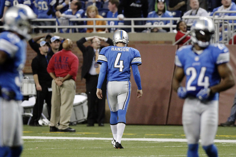 Photo -   Detroit Lions kicker Jason Hanson (4) walks off the field after missing a 47-yard field goal attempt in overtime of an NFL football game against the Houston Texans, Thursday, Nov. 22, 2012, in Detroit. The Texans won 34-31. (AP Photo/Duane Burleson)