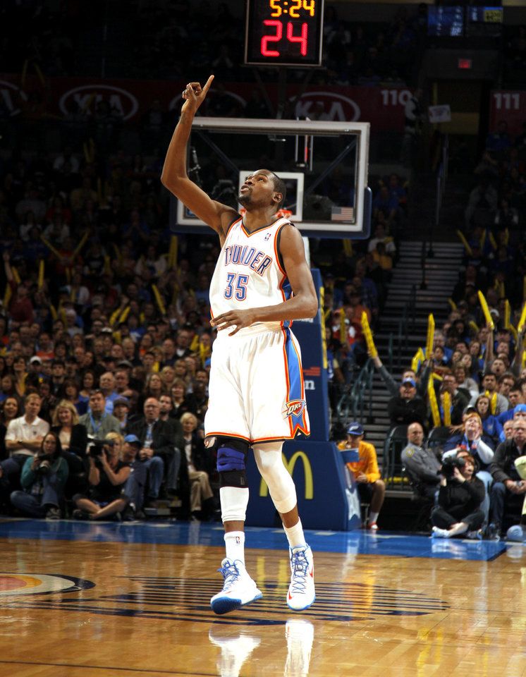 Photo - Oklahoma City's Kevin Durant (35) celebrates during the NBA basketball game between the Oklahoma City Thunder and the Cleveland Cavaliers at the Chesapeake Energy Arena, Sunday, Nov. 11, 2012. Photo by Sarah Phipps, The Oklahoman
