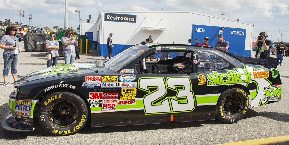 Shattuck�s Purgason Tire is featured on the No. 23 NASCAR Nationwide Series car that will race at  Daytona International Speedway on Saturday. Shop owner Bryan Purgason made a roadside rescue of the car�s sponsor this month. Photo provided