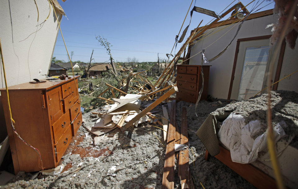 Photo - A bedroom is seen in Woodward, Okla., Sunday, April 15, 2012. A tornado that killed five people struck Woodward, Okla., shortly after midnight on Sunday, April 15, 2012.  Photo by Bryan Terry, The Oklahoman