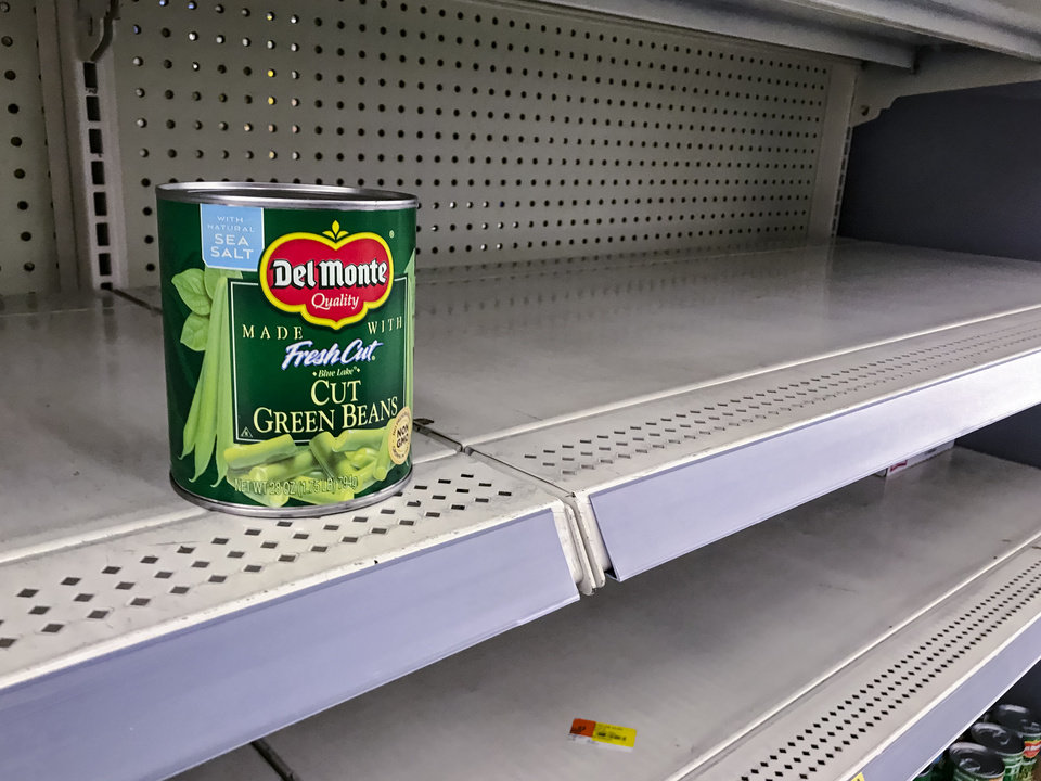 Photo - Empty shelves in the can food isle at Walmart in Mustang, Okla. on Monday, March 16, 2020.    [Chris Landsberger/The Oklahoman]