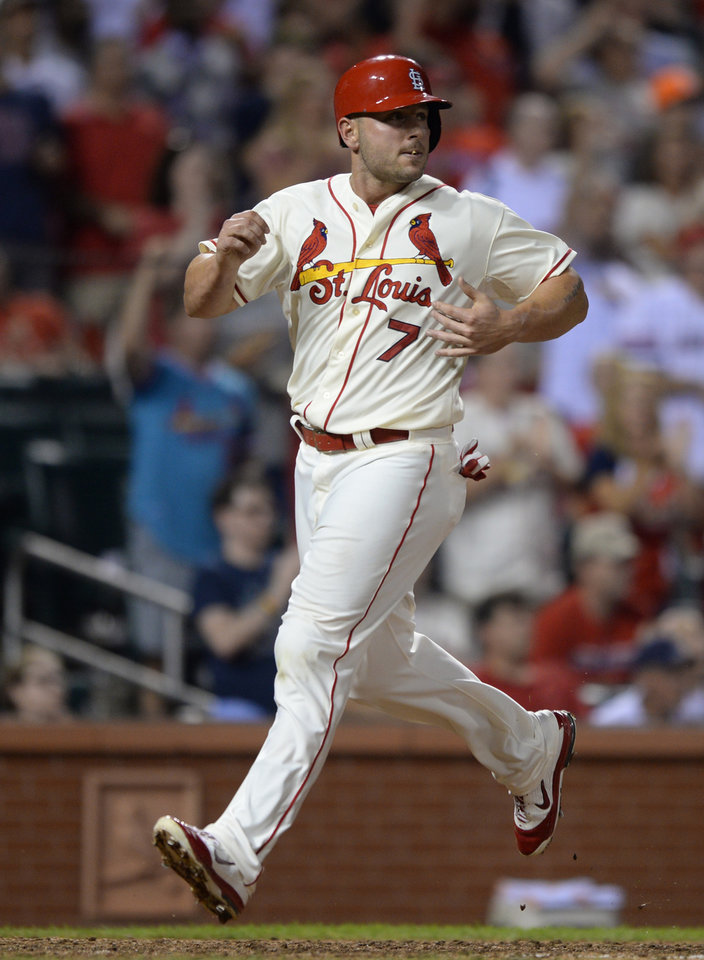 Photo - St. Louis Cardinals' Matt Holliday scores on an RBI triple by Matt Adams against the San Diego Padres in the fifth inning in a baseball game, Saturday, Aug, 16, 2014, at Busch Stadium in St. Louis. (AP Photo/Bill Boyce)