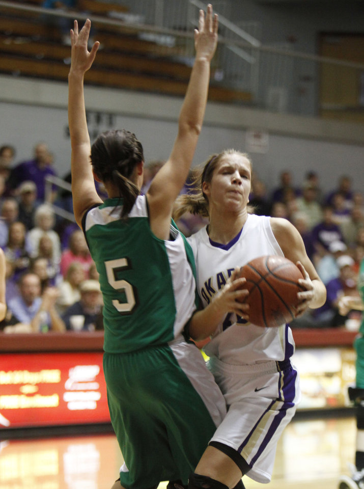 Okarche's Morgan Vogt bumps against Stonewall's Haley Snell during the girl's class A basketball playoffs at Southern Nazarene University's Sawyer Center in Bethany, OK, Thursday, March 1, 2012. By Paul Hellstern, The Oklahoman