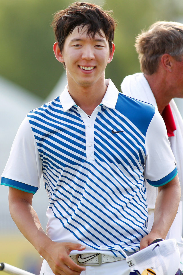Photo - Seung-Yul Noh, of South Korean, smiles after making par on the 18th hole during the third round of the PGA Zurich Classic golf tournament at TPC Louisiana in Avondale, La., Saturday, April 26, 2014. (AP Photo/Jonathan Bachman)