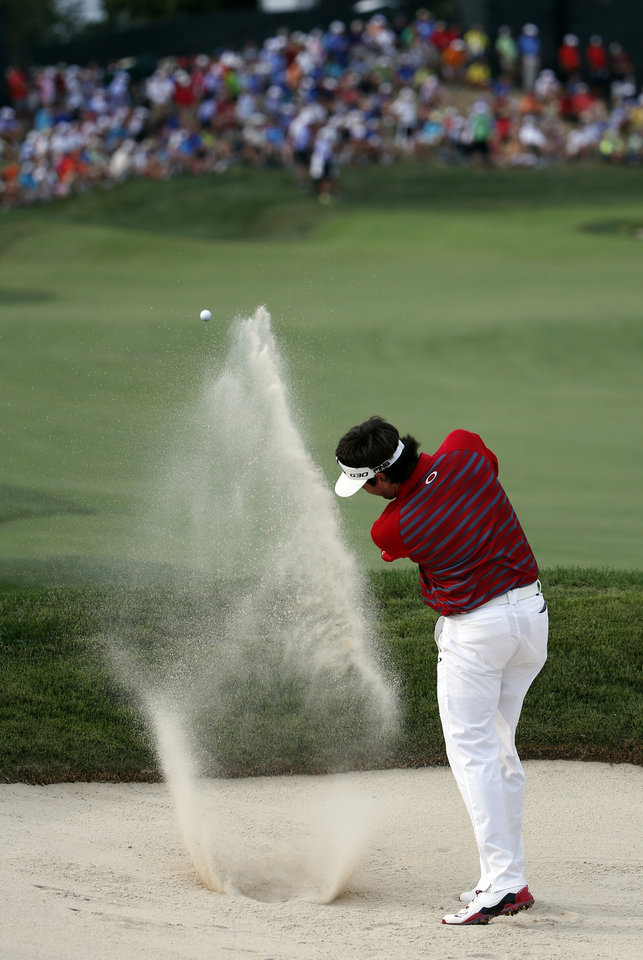 Photo - Bubba Watson hits out of the bunker on the 18th hole during the first round of the PGA Championship golf tournament at Valhalla Golf Club on Thursday, Aug. 7, 2014, in Louisville, Ky. (AP Photo/Mike Groll)