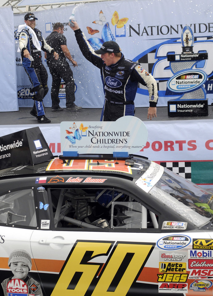Photo - Chris Buescher celebrates after winning the NASCAR Nationwide Series Nationwide Children's Hospital 200 auto race at Mid-Ohio Sports Car Course, Saturday, Aug. 16, 2014, in Lexington, Ohio. (AP Photo/Tom E. Puskar)