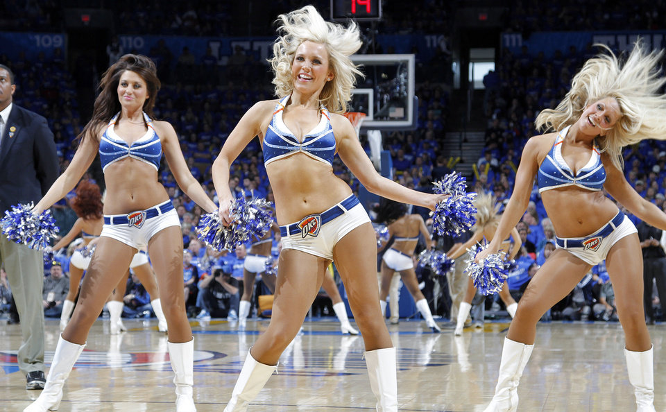 Photo - The Thunder Girls perform during game one of the Western Conference semifinals between the Memphis Grizzlies and the Oklahoma City Thunder in the NBA basketball playoffs at Oklahoma City Arena in Oklahoma City, Sunday, May 1, 2011. Photo by Chris Landsberger, The Oklahoman
