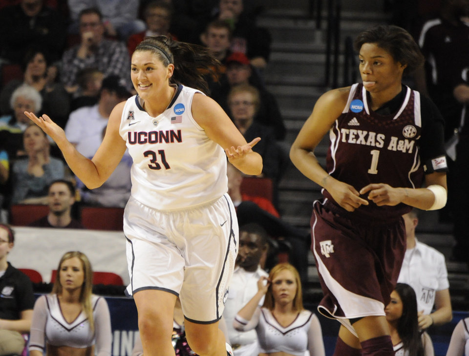 Photo - Connecticut's Stefanie Dolson (31) and Texas A&M's Courtney Williams (1) during the first half of their Monday March 31, 2014 regional final in the NCAA college basketball tournament in Lincoln, Neb.(AP Photo/Dave Weaver)