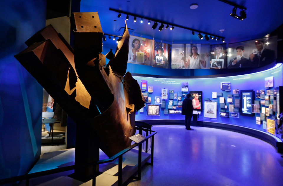 """Photo - FILE- In this May 14, 2014 file photo, steel from the World Trade Center north tower floors 97 and 98, left, is displayed at the National Sept. 11 Memorial Museum in New York. The museum was designed to accurately depict the events for September 11, 2001 while not making the presentation intolerable for the public. One designer who helped create the exhibits says """"there's a lot of thought given to the psychological safety of visitors."""" (AP Photo)"""