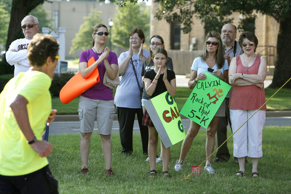 Photo -  Fans cheer on runners in last year's 5K to Monet event in downtown Edmond. Photo by Paul Hellstern, The Oklahoman Archives   PAUL HELLSTERN -  Oklahoman