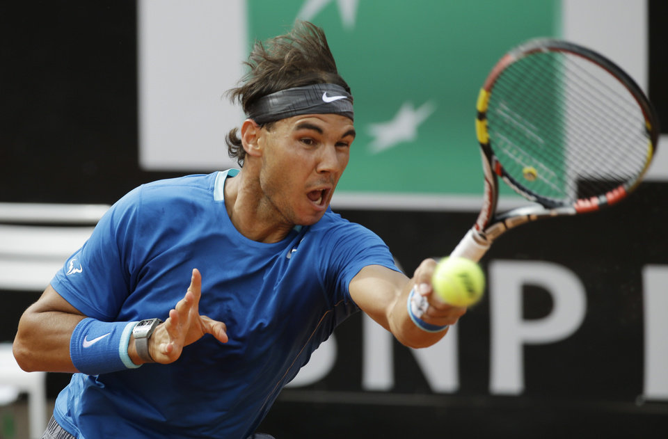 Photo - Spain's Rafael Nadal returns the ball to Serbia's Novak Djokovic during their final match at the Italian Open tennis tournament, in Rome, Sunday, May 18, 2014. (AP Photo/Andrew Medichini)
