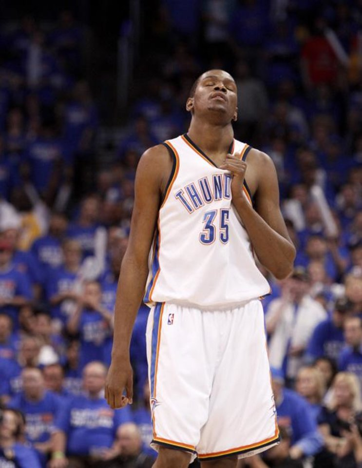 Photo -  NBA PLAYOFFS / L.A. LAKERS / REACTION: Oklahoma CIty's Kevin Durant reacts during the NBA basketball game between the Los Angeles Lakers and the Oklahoma City Thunder in game six of the first round series at the Ford Center in Oklahoma City, Friday, April 30, 2010. Photo by Bryan Terry, The Oklahoman ORG XMIT: KOD