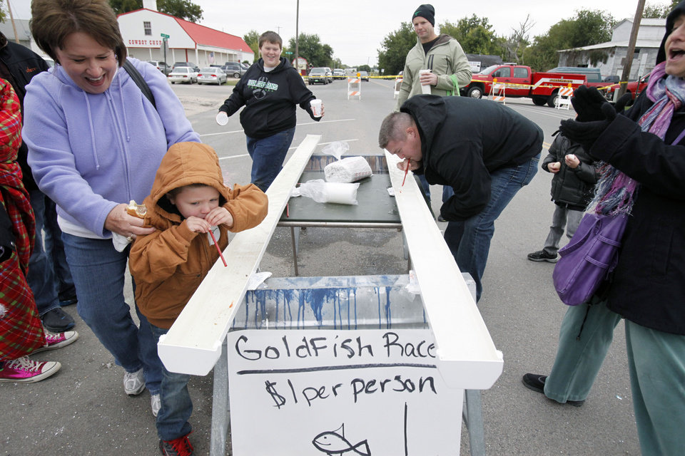 Five year old Cayman Ashby and his dad Tyler compete in goldfish races during the Jones Old Timers Day celebration in Jones, OK, Saturday, October 6, 2012,  By Paul Hellstern, The Oklahoman