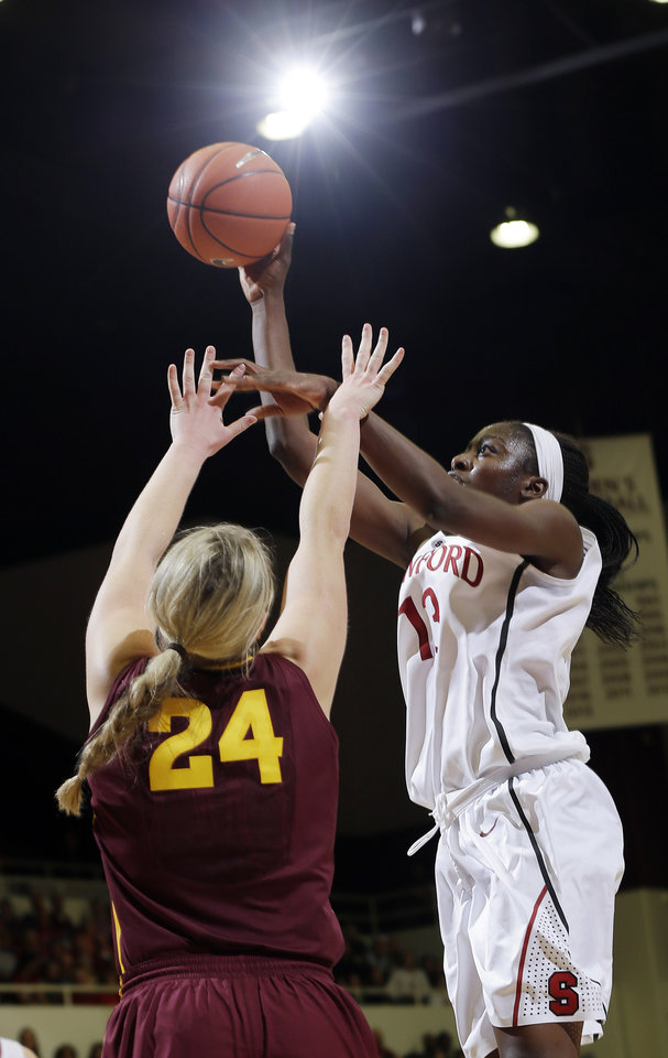 Photo - Stanford forward Chiney Ogwumike, right, shoots over Arizona State forward Kelsey Moos during the first half of an NCAA college basketball game Friday, Feb. 14, 2014, in Stanford, Calif. (AP Photo/Marcio Jose Sanchez)