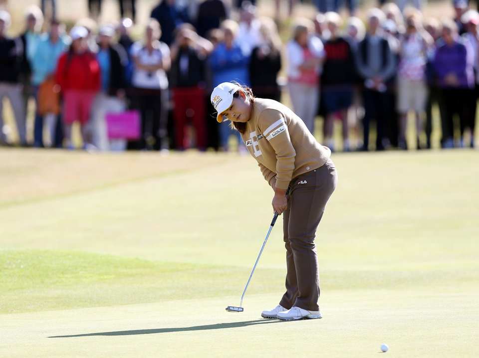 Photo - South Korea's Inbee Park putts on the 18th green during the Final day of the Women's British Open golf championship at the Royal Birkdale Golf Club, in Southport, England, Sunday, July 13, 2014. (AP Photo/Scott Heppell)