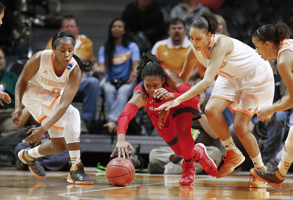 Photo - St. John's forward Amber Thompson, center, dives for a loose ball with Tennessee's Jordan Reynolds, left, Cierra Burdick (11), and Andraya Carter, right, in the first half of an NCAA women's college basketball second-round tournament game Monday, March 24, 2014, in Knoxville, Tenn. (AP Photo/John Bazemore)
