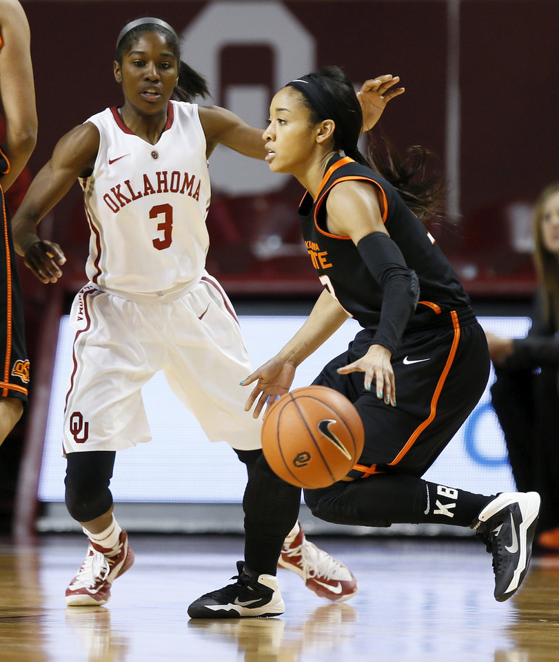 Photo - Oklahoma State's Tiffany Bias (3) dribbles near Oklahoma's Aaryn Ellenberg (3) in the second half during a women's Bedlam college basketball game between the Oklahoma State University Cowgirls (OSU) and the University of Oklahoma Sooners (OU) at Lloyd Noble Center in Norman, Okla., Saturday, Feb. 1, 2014. OU won, 81-74. Photo by Nate Billings, The Oklahoman