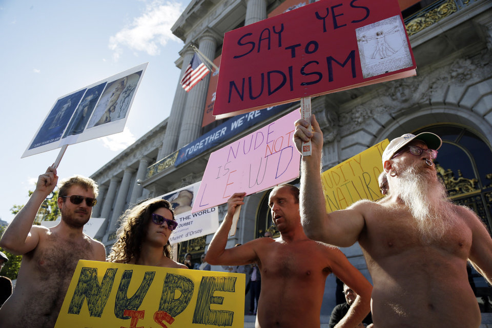 Demonstrators gather at a protest against a proposed nudity ban outside of City Hall in San Francisco, Wednesday, Nov. 14, 2012. San Francisco appears poised to shed part of its image as a city where anything goes, including clothing. The Board of Supervisors is scheduled to vote next week on a law that would ban public nudity. The proposal comes in response to a devoted group of nudists who proudly strut their stuff through the city�s Castro District. (AP Photo/Marcio Jose Sanchez)
