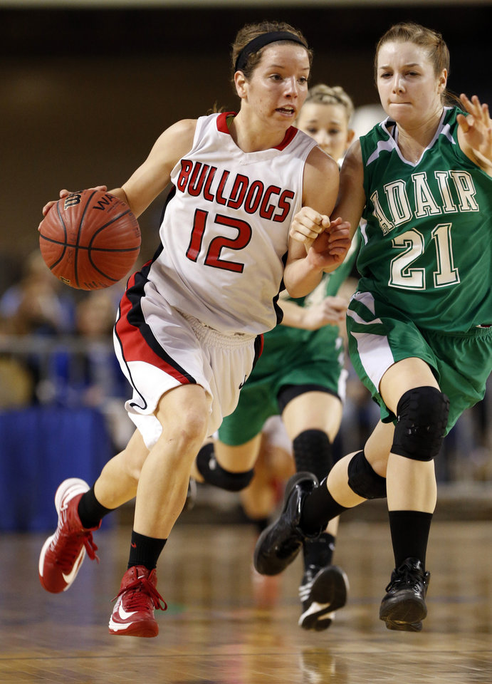 Adair's Rendi Rogers (21) tries to slow Sulphur's Ashley Hughes on a fast break during the 3A girls semifinal game between the Adair High School Lady Warriors and the Sulphur Lady Bulldogs at the State Fair Arena on Friday, March 8, 2013 in Oklahoma City, Okla.  Photo by Steve Sisney, The Oklahoman