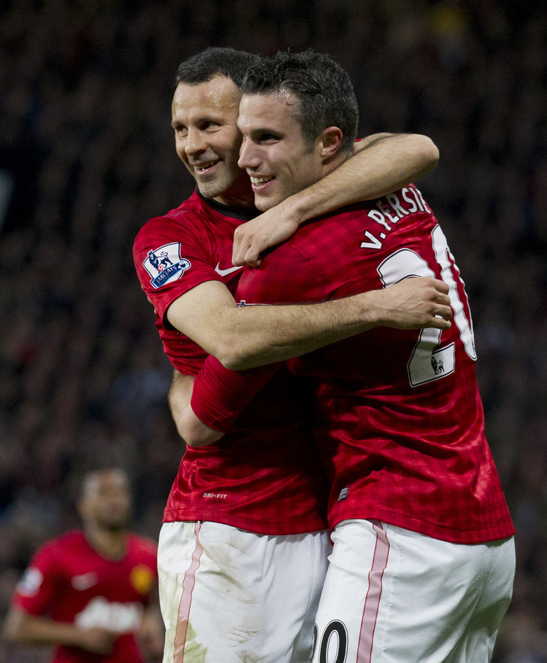 Photo - Manchester United's Robin van Persie, right, celebrates with teammate Ryan Giggs after scoring his third goal against Aston Villa during their English Premier League soccer match at Old Trafford Stadium, Manchester, England, Monday April 22, 2013. (AP Photo/Jon Super)