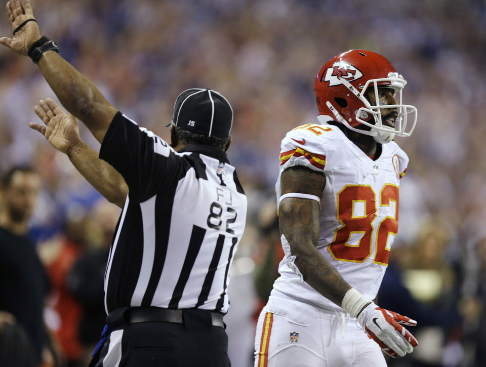 Photo - Kansas City Chiefs' Dwayne Bowe reacts after his reception is ruled out of bounds in the final moments of an NFL wild-card playoff football game against the Indianapolis Colts Saturday, Jan. 4, 2014, in Indianapolis. Indianapolis defeated Kansas City 45-44. (AP Photo/Michael Conroy)