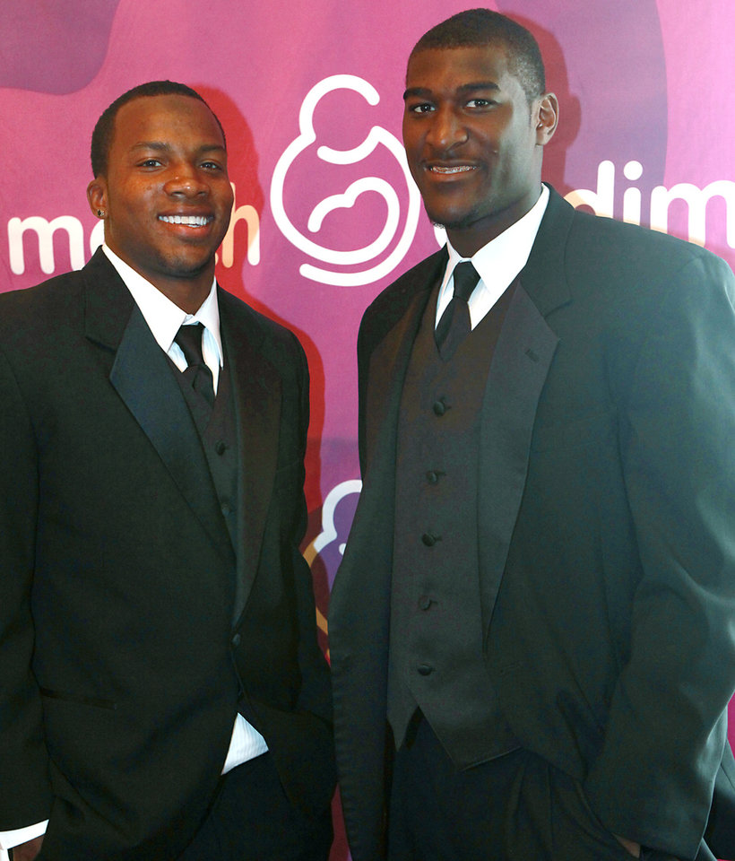 Photo - OU's Ryan Broyles (left) and OSU's Justin Blackmon (right) pose prior to the March of Dimes Sports Headliner Banquet 2011 at the Skirvin Hilton in Oklahoma City on Monday, April 18, 2011. Photo by John Clanton, The Oklahoman ORG XMIT: KOD