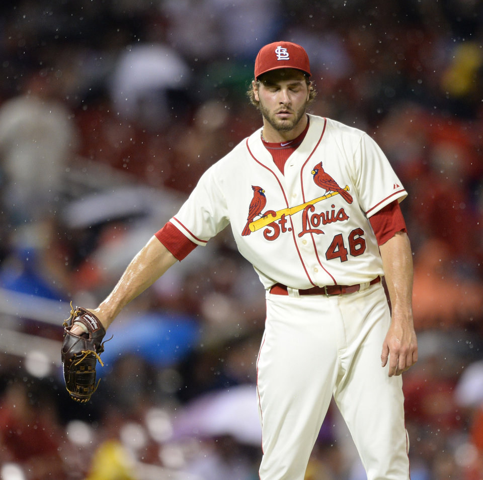 Photo - St. Louis Cardinals' Kevin Siegrist ooks down after giving up a grand slam to San Diego Padres' Jedd Gyorko in the seventh inning in a baseball game, Saturday, Aug. 16, 2014, at Busch Stadium in St. Louis. The Padres won 9-5.  (AP Photo/Bill Boyce)